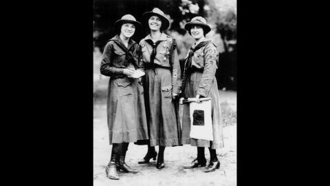 """<strong>1910s:</strong> Juliette Gordon Low hoped to create an organization """"that would prepare girls to meet their world with courage, confidence and character."""" Dorothy Fath, left, Capt. Rhonda Piggot, middle, and Viola Oates from Cleveland Pansy Troop No. 1, shown here around 1919, were some of the first girls to benefit from Low's lofty mission."""