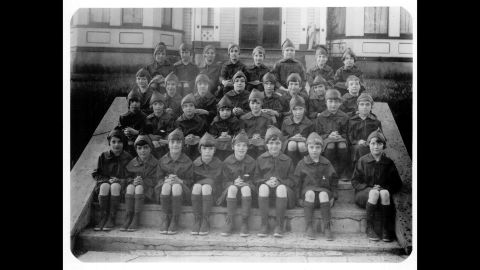 <strong>1920s:</strong> A troop of Girl Scout Brownies is shown wearing the first official Brownie uniform in 1926. Today's Brownies are second and third graders who start learning new skills through earning badges and doing projects to help their community.