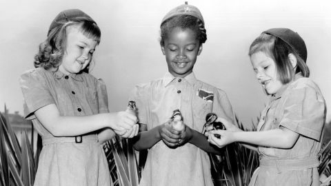 """<strong>1950s:</strong> An integrated group of Girl Scout Brownies learned farming firsthand, circa 1950. It wasn't just a fluke. In 1956, the Rev. Martin Luther King Jr. called the Girl Scouts  <a href=""""http://www.girlscoutshs.org/blog/posts/a-martin-luther-king-jr-day-message-from-anna-maria-chvez"""" target=""""_blank"""" target=""""_blank"""">a """"force for desegregation."""" </a>Today, that principle extends to <a href=""""http://www.cnn.com/2015/05/20/living/girl-scouts-welcomes-transgender-girls-feat/"""">transgender girls</a>."""
