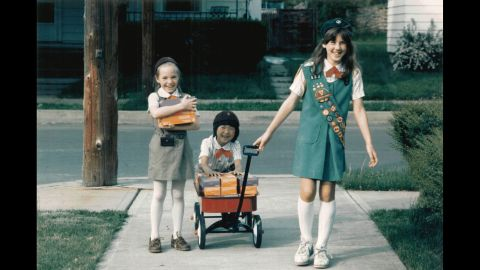 """<strong>1980s:</strong> A Girl Scout Junior helps Girl Scout Brownies with cookie deliveries, circa 1984. """"Cookies are so much more than a fundraiser,"""" says psychologist Andrea Bastiani Archibald, the Girl Scouts' chief girls expert. """"When someone buys a box of cookies, they're helping girls develop their financial literacy skills, their social skills ... and their business ethics. Girls  can carry these skills into the rest of their lives."""""""