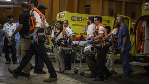 An injured Israeli soldier is taken into Hadas hospital on October 17 in Jerusalem after being stabbed in the West Bank city of Hebron.