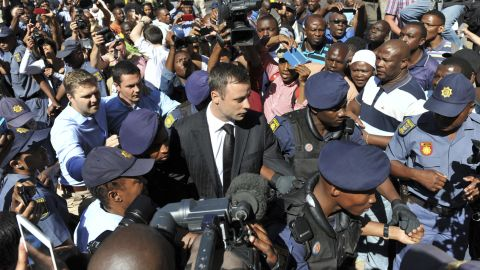 Pistorius arrives outside a courtroom in Pretoria in October 2014. He was initially convicted of culpable homicide and sentenced to five years in prison, but a higher court reversed it to murder after an appeal.