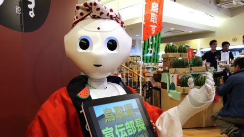 """All 1,000 units of """"Pepper"""" being offered in September sold out within one minute, according to its creator Softbank Robotics. """"Pepper"""" is being promoted as the world's first personal robot, seen here promoting the sale of watermelons on July 1, 2015. It's also being marketed as a companion for the elderly."""