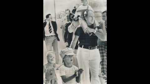Prime Minister Pierre Trudeau takes  an outing in Winnipeg, Manitoba, while on vacation in 1977 with his sons, from left, Sacha, Justin and Michel. The elder Trudeau was Canada's Prime Minister from 1968 to 1979 and again from 1980 to 1984.