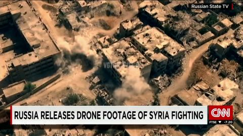 Highly-produced drone footage is broadcast to Russian homes showing smoke billowing from a Damascus suburb.