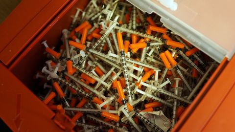 Needle exchange is another strategy used to reduce infections among drug users. Pictured, ysed syringes are viewed at a needle exchange clinic in, Vermont, USA.