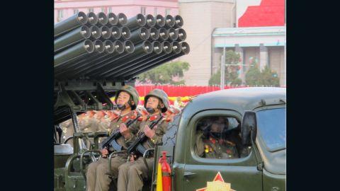 Young members of North Korea's military ride artillery through Pyongyang.