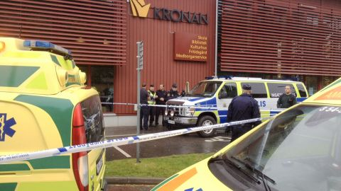 Emergency services attend the scene after a masked man attacked people with a sword, at the Kronan school in Trollhattan, near Goteborg, Sweden, Thursday Oct. 22, 2015. At least six people were injured, and the offender was shot by the police. (Stig Hedstrom/TT via AP) SWEDEN OUT