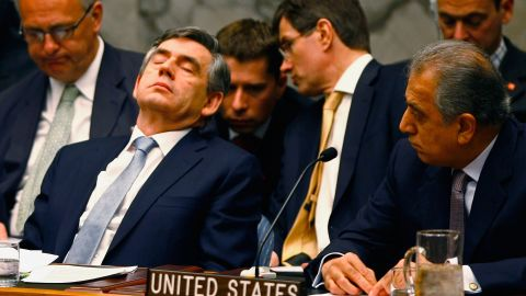 """Then-British Prime Minister Gordon Brown (L) """"rests his eyes"""" during a U.N. Security Council meeting in New York in April 2008."""