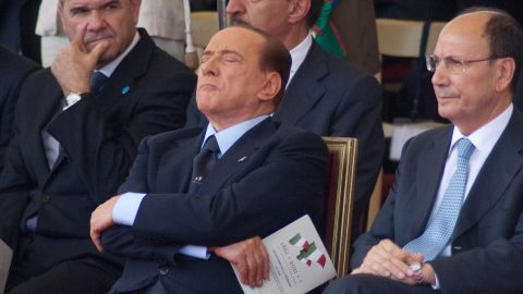 Former Italian Prime Minister Silvio Berlusconi (C) takes a nap during a military parade to mark the the 150th anniversary of Italian unification in Rome in June 2011.