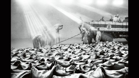 """Coffee farmers work at a warehouse in the Indian state of Karnataka in 2003. Sebastiao Salgado has images from 10 different countries in his new photo book, """"The Scent of a Dream: Travels in the World of Coffee."""""""
