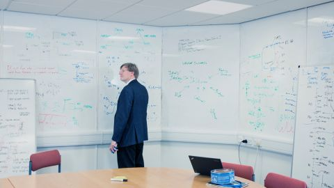 """Anders Sandberg is a research fellow at the Future of Humanity Institute at Oxford University. Shown here in what he jokingly calls his """"natural environment in front of a white board,"""" Sandberg describes his work as mostly """"long-range research into — literally — the state of our species."""" """"I'm essentially living in the future,"""" Sandberg said. """"I'm trying to think ahead. But prediction is really hard. The interesting questions is: Can we learn what we are actually able to predict and which areas we should give up on?"""""""