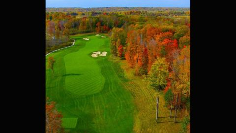 """Our second entry comes from <a href=""""https://instagram.com/aerialagents/"""" target=""""_blank"""" target=""""_blank"""">@aerialagents</a>. """"One of the most visually impressive holes on this Tom Fazio designed course,"""" they explain. """"Sand Ridge Golf Club is built on 370 acres of woods, pastures and wetlands."""" The vast array of colors in the trees are evidence of this."""