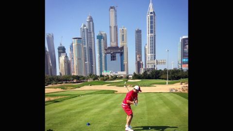 """Perhaps one of the more distinctive backdrops on the list, the Emirates Golf club in Dubai provides something a little different to trees, seas or sunsets. Home to the Burj Khalifa, the world's tallest building, the impressive skyline is certainly an alternative location to play a round in front of. Thanks to <a href=""""https://instagram.com/p/y1bNsFixyL/?taken-by=brian_will85"""" target=""""_blank"""" target=""""_blank"""">@brian_will85</a> for sending this photo."""