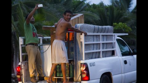 Residents of Boca de Pascuales, Mexico, leave the village on October 22.