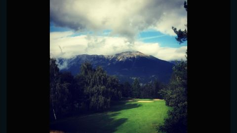 """Not a country with a rich golf history, Slovenia, nevertheless, provides one of the more dramatic backdrops on our list. Overlooked by the highest point of the Slovenian Alps, and often just below the clouds, <a href=""""https://instagram.com/dragobilic/"""" target=""""_blank"""" target=""""_blank"""">@dragobilic</a>'s submission is the only Slovenian course on Golf World Magazine's Top 100 European Golf Courses."""