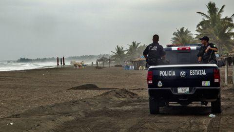 Police patrol the beach in Boca de Pascuales on October 22.