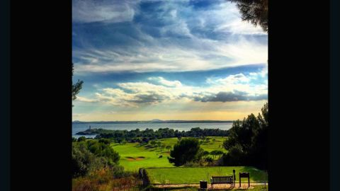 """This snap sent to us by <a href=""""https://instagram.com/enderlix/"""" target=""""_blank"""" target=""""_blank"""">@enderlix</a> captures the sun's rays piercing through the clouds and into the Mediterranean Sea. """"The club takes its name from a nearby island just off the shore which, complete with its own lighthouse, can be seen from most of the holes,"""" the club says."""