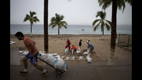 Residents fill sandbags to protect beachfront businesses in Puerto Vallarta on October 23.