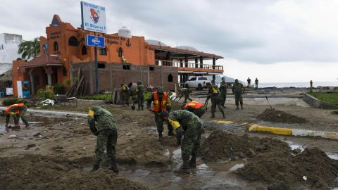 Mexican soldiers remove sand from the street in Manzanillo, Colima state, on Saturday, October 24, after Hurricane Patricia hit the coast of neighboring Jalisco state.