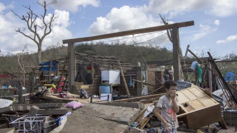 Residents of the  Chamela community clear the debris left by Hurricane Patricia  in the state of  Jalisco, Mexico on October 24,  2015. Patricia flattened dozens of homes on Mexico's Pacific coast, but authorities said Saturday the record-breaking hurricane largely spared the country as it weakened to a tropical depression. AFP PHOTO/HECTOR GUERRERO        (Photo credit should read HECTOR GUERRERO/AFP/Getty Images)