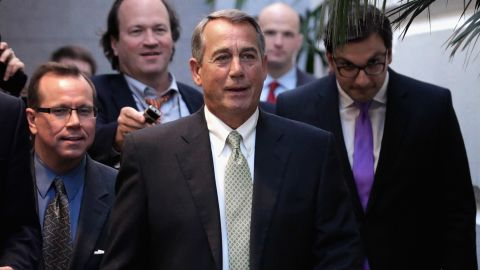 """Speaker of the House John Boehner, tells reporters that he is """"cleaning out the barn, cleaning out the barn,"""" as he heads to a GOP conference meeting at the begining of his last week in the House of Representatives October 26 in Washington, DC. The White House and Boehner may be nearing a two-year budget deal that would avert another government shutdown, increase defense and defense spending by $80 billion and extend the debt limit through to March 2017, clearing it away until after the 2016 elections."""