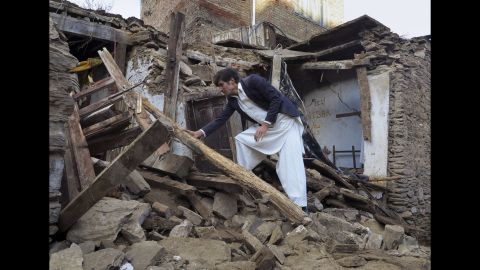 A man sifts through the rubble of a house in Mingora, Pakistan, on Tuesday, October 27.