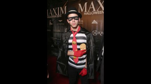Nick Jonas showed up at the Maxim Halloween Party on Saturday, October 24, dressed as his criminal alter ego, the Hamburglar.
