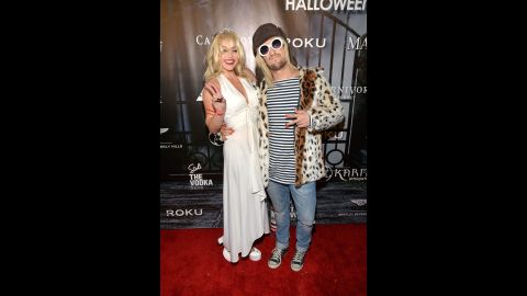 """""""Dancing With the Stars' """" Mark Ballas and girlfriend BC Jean brought some grungy glamor to the Maxim party as Kurt Cobain and Courtney Love."""