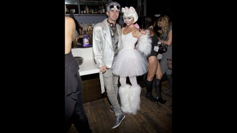 """""""Modern Family"""" actress Sarah Hyland dressed as a snow-white kitty for Matthew Morrison's Halloween Masquerade Ball."""