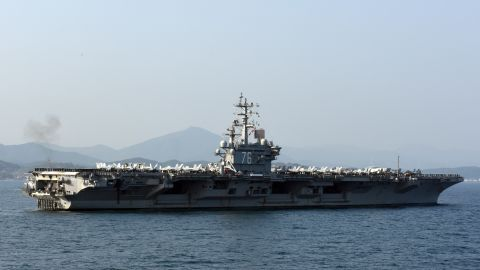 151023-N-AD372-027 BUSAN, Republic of Korea, (Oct. 23, 2015) Sailors aboard the U.S. Navy's only forward-deployed aircraft carrier USS Ronald Reagan (CVN 76), man the rails while participating in the Republic of Korea Navy's Fleet Review. The fleet review celebrated the 70th anniversary of the ROK Navy and served as a symbol of the enduring U.S. and ROK alliance. (U.S. Navy photo by Mass Communication Specialist 1st Class Abraham Essenmacher/Released)