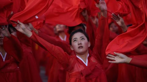 Dancers perform during a mass military parade at Kim Il-Sung square in Pyongyang on October 10, 2015. North Korea was marking the 70th anniversary of its ruling Workers' Party.  (Photo credit: ED JONES/AFP/Getty Images)
