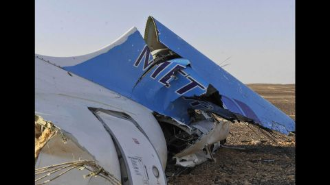 The tail of the jet sits in a field on October 31.