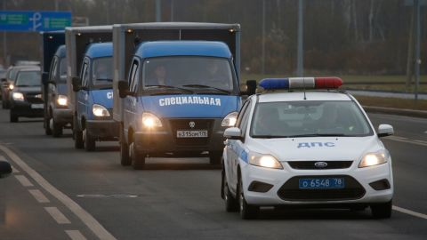 Trucks in St. Petersburg carry victims' bodies on Monday, November 2.