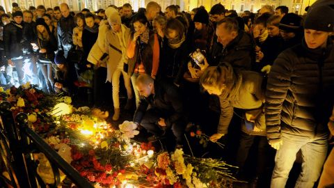 People light candles and place flowers in central Saint Petersburg.