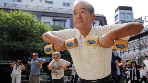 Japan has the longest-living population in the world with people living, on average, to the age of 86. Experts suggest this is due to a combination of good diets, active lifestyles and supportive family structure. Pictured, Elderly people work out with wooden dumb-bells in the grounds of a temple to celebrate Japan's Respect for the Aged Day.