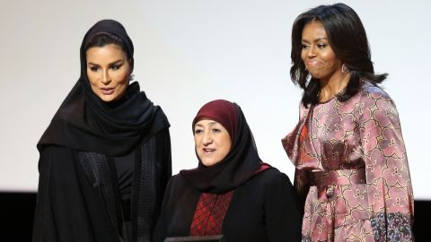 Afghan Dr. Sakena Yacoobi, center, receives a prize from Obama and Sheikha Moza bint Nasser, chairwoman of the Qatar Foundation, during the education summit on November 4. Yacoobi is the CEO of the Afghan Institute of Learning, which she founded in 1996.
