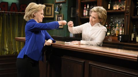 """""""Miley Cyrus"""" Episode 1684 -- Pictured: (l-r) Kate McKinnon as Hillary Clinton and Hillary Clinton a Val during the """"Bar Talk"""" sketch on October 3, 2015."""