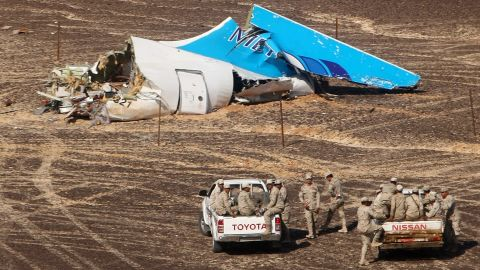"""Members of the Egyptian military approach the wreckage of a Russian passenger plane Sunday, November 1, in Hassana, Egypt. <a href=""""http://www.cnn.com/2015/10/31/world/gallery/russian-plane-crash/index.html"""" target=""""_blank"""">The plane crashed</a> the day before, killing all 224 people on board. ISIS claimed responsibility for downing the plane, but the group's claim wasn't immediately verified."""