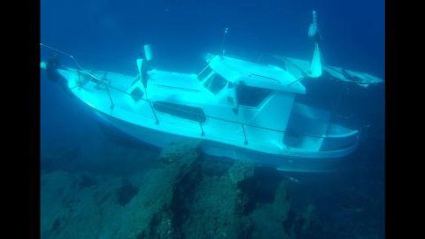 The Kusadasi Ilgun, a sunken 20-foot boat, lies in waters off the Greek island of Samos in November 2016.