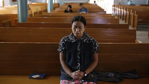 A devotee prays at a chanting ceremony in Mandalay, Myanmar, on November 7 to bless citizens and to pray for a fair and peaceful election.
