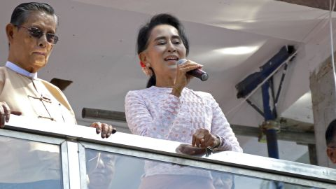 Myanmar's opposition leader Aung San Suu Kyi delivers a speech next to party patron Tin Oo in Yangon, Myanmar on November 9, 2015.