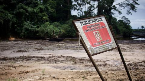 A sign warns people to stay off land contaminated by oil pollution.