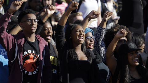 Students cheer while listening to members of the black student protest group Concerned Student 1950 speak following the announcement that University of Missouri System President Tim Wolfe would resign Monday, Nov. 9, 2015, at the university in Columbia, Mo. Wolfe resigned Monday with the football team and others on campus in open revolt over his handling of racial tensions at the school. (AP Photo/Jeff Roberson)