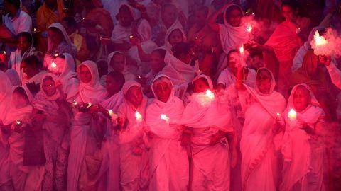 Hindu widows in Vrindavan, India, burn firecrackers on the eve of Diwali on Tuesday, November 10.