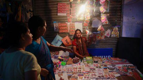 Women shop at a roadside stall in Mumbai on November 10.