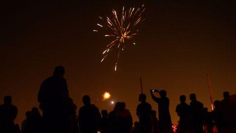 Athletes watch fireworks at the Madan Mohan Malviya Stadium in Allahabad, India, on November 10.