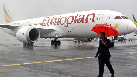 """A Boeing 787 Dreamliner is hosed down on arrival in Addis Ababa on August 17, 2012. Ethiopian Airlines received Africa's first Boeing 787 Dreamliner on Friday, making Ethiopia the only country aside from Japan to operate the innovative aircraft. """"As a continent this shows how much we are making progress as Africans... competing on the global stage and changing our image,"""" Ethiopian Airline CEO Tewolde Gebremariam told reporters  AFP PHOTO/JENNY VAUGHAN.        (Photo credit should read JENNY VAUGHAN/AFP/GettyImages)"""