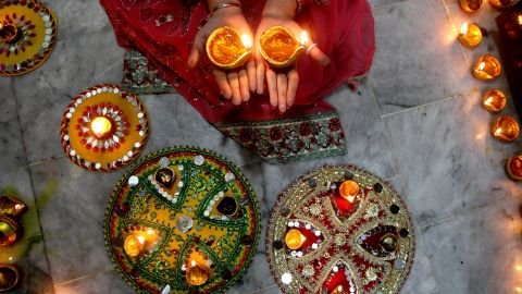 A Hindu woman lights candles during Diwali celebrations at a temple in Lahore, Pakistan, on November 11.