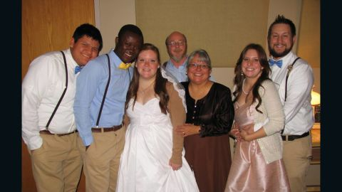 Kristin and Eric Njimegni pose with her family during their wedding reception in Grand Rapids, Minnesota, on December 2013.